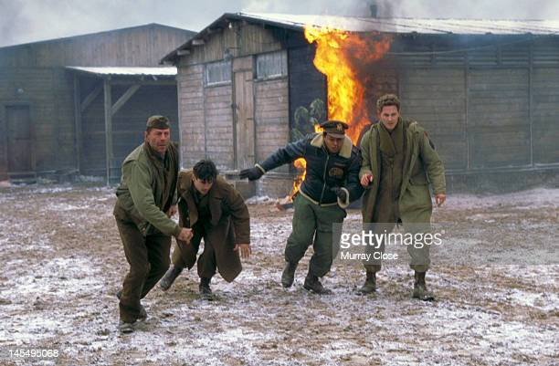 From left to right actors Bruce Willis Colin Farrell Terrence Howard and Cole Hauser in a scene from the film 'Hart's War' 2002