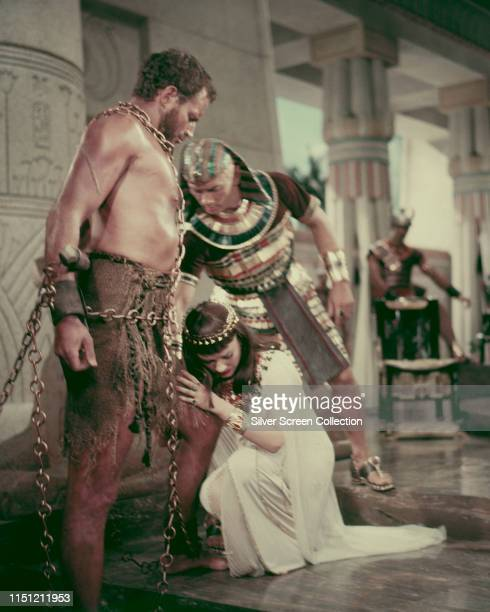 From left to right actors Charlton Heston as Moses Anne Baxter as Nefretiri and Yul Brynner as Pharaoh Rameses II in a scene from the biblical epic...