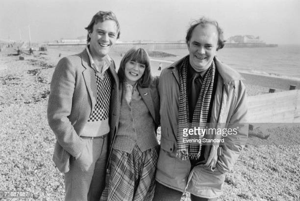 From left to right actors Christopher Cazenove and Alison Steadman and English playwright Alan Ayckbourn on the beach at Brighton 1979