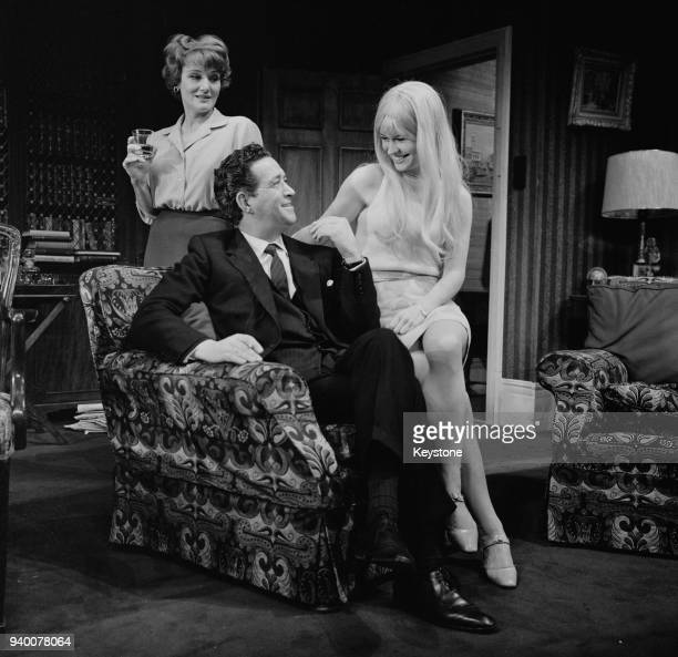 From left to right actors Constance Cummings as Liza Foot John Gregson as MP Joe Malkin and Wendy Varnals as a pop singer during a rehearsal for the...