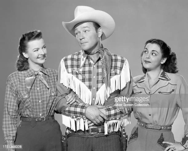 From left to right, actors Dale Evans, Roy Rogers and Estelita Rodriguez in a publicity shot for the Western film 'Twilight in the Sierras', 1950.