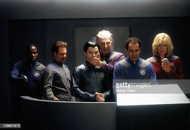 From left to right actors Daryl Mitchell Sam Rockwell Jed Rees Alan Rickman Tony Shalhoub and Sigourney Weaver in a scene from the film 'Galaxy...