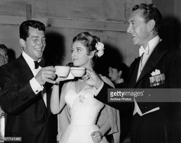 From left to right actors Dean Martin Anna Maria Alberghetti and Paul Henreid enjoy a coffee break on the set of the MGM film 'Ten Thousand Bedrooms'...