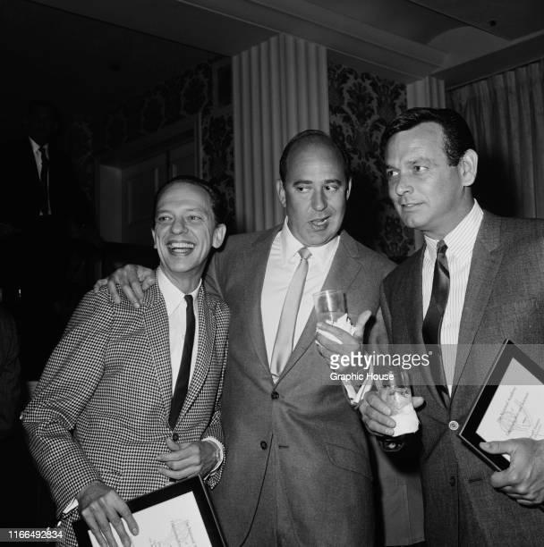 From left to right actors Don Knotts Carl Reiner and David Janssen at the CBS Emmy nomination party 1966 Knotts and Janssen are both holding their...