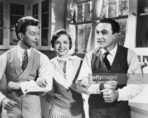 From left to right actors Donald O'Connor Debbie Reynolds and Gene Kelly in the 'Good Morning' sequence from the musical film 'Singin' in the Rain'...