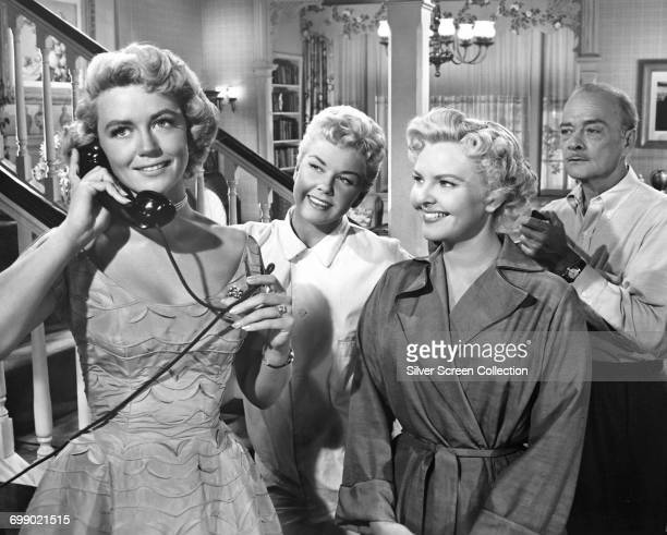 From left to right actors Dorothy Malone as Fran Tuttle Doris Day as Laurie Tuttle Elisabeth Fraser as Amy Tuttle and Robert Keith as Gregory Tuttle...