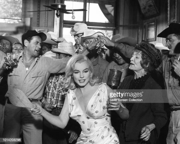 From left to right, actors Eli Wallach, Marilyn Monroe and Estelle Winwood in the paddle-ball scene from the film 'The Misfits', 1961.