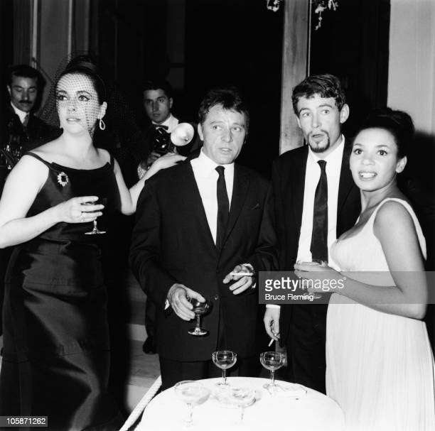From left to right actors Elizabeth Taylor Richard Burton Peter O'Toole and singer Shirley Bassey 1960s