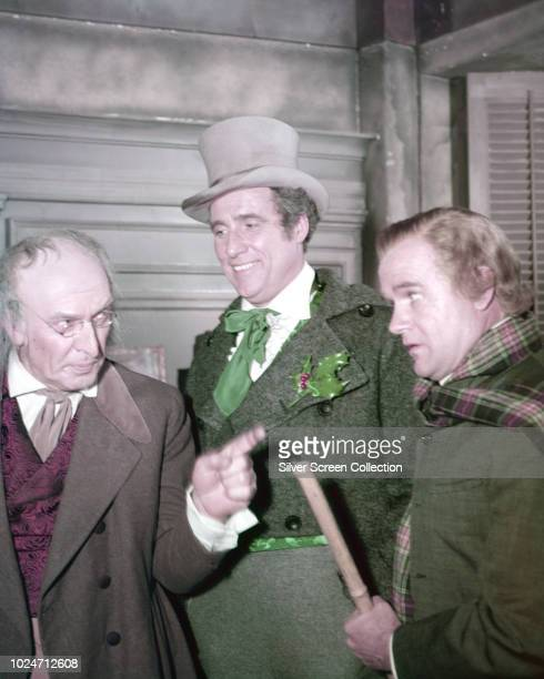 From left to right actors Fredric March as Scrooge Ray Middleton as Fred and Bob Sweeney as Bob Cratchit in 'A Christmas Carol' an episode of the CBS...