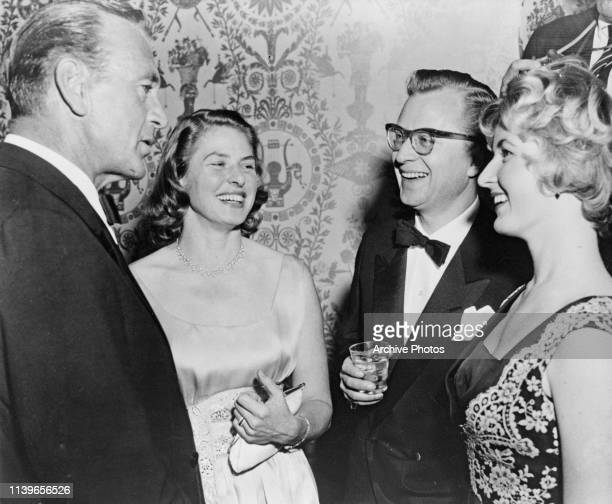 From left to right, actors Gary Cooper and Ingrid Bergman, her husband Lars Schmidt and her daughter Pia Lindstrom at a party in Hollywood,...