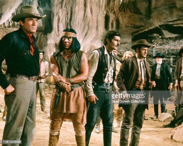 From left to right, actors Gregory Peck as Marshal Sam Mackenna, Robert Phillips as Monkey, Omar Sharif as John Colorado and Eli Wallach as Ben Baker...