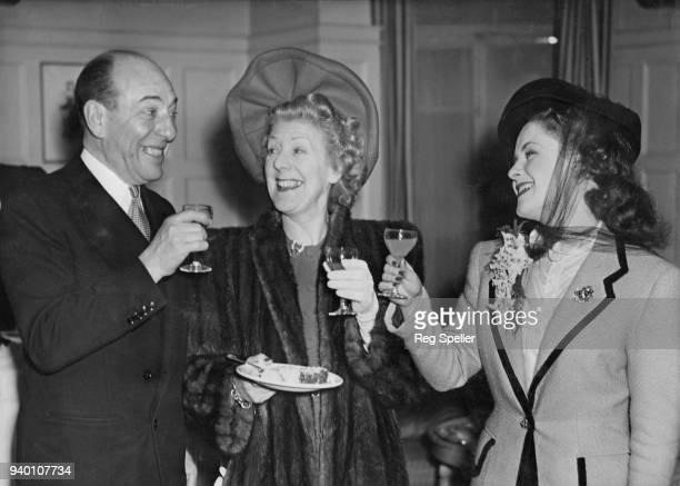 From left to right actors Hartley Power Cicely Courtneidge and Betty Paul at the Savoy Hotel in London at a reception celebrating the wedding of...
