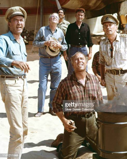 From left to right actors James Stewart as Frank Towns George Kennedy as Bellamy and Peter Finch as Captain Harris in a scene from the film 'The...