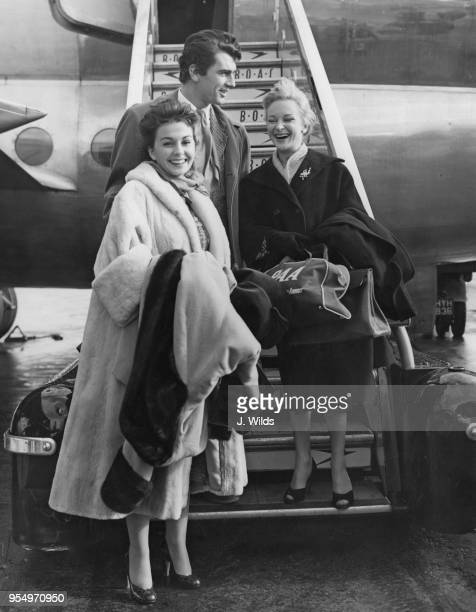 From left to right, actors Jean Simmons , Edmund Purdom and Joan Greenwood arrive at London Airport from Hollywood, 24th October 1954.