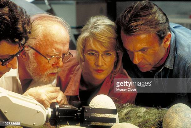 From left to right actors Jeff Goldblum as Dr Ian Malcolm Richard Attenborough as John Hammond Laura Dern as Dr Ellie Sattler and Sam Neill as Dr...