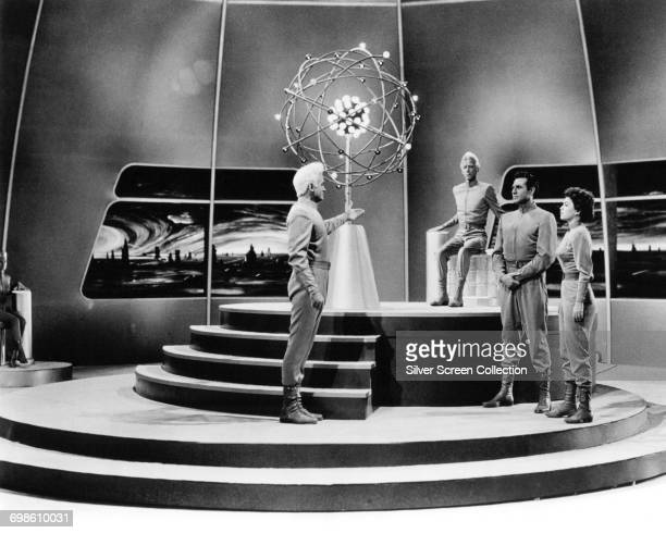 From left to right actors Jeff Morrow as Exeter Douglas Spencer as The Monitor Rex Reason as Dr Cal Meacham and Faith Domergue as Dr Ruth Adams in a...
