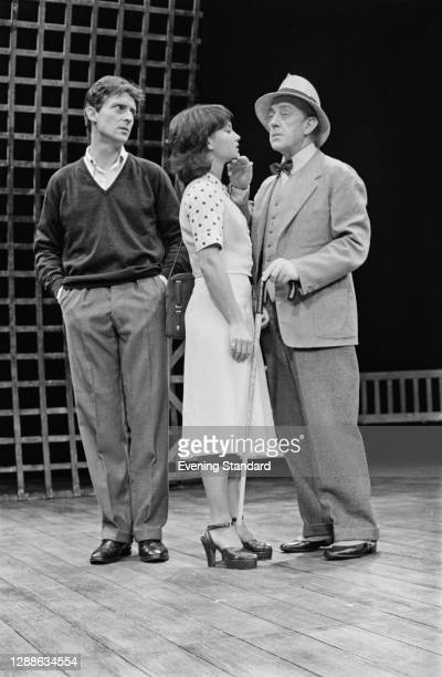 From left to right, actors Jeremy Brett, Nicola Pagett and Alec Guinness star in the play 'A Voyage Round My Father' at the Haymarket Theatre in...