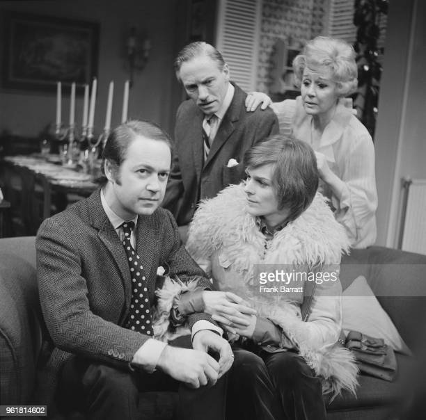 From left to right actors John Standing as Lorn Mason Michel des Barres as Jo Delaney and Alan MacNaughton as George Mason and Margaret Leighton as...