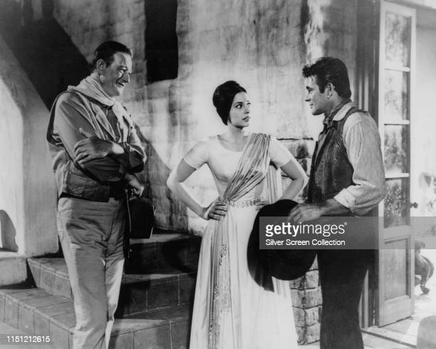 From left to right actors John Wayne as Captain Jake Cutter Ina Balin as Pilar Graile and Stuart Whitman as Paul Regret in the Western film 'The...