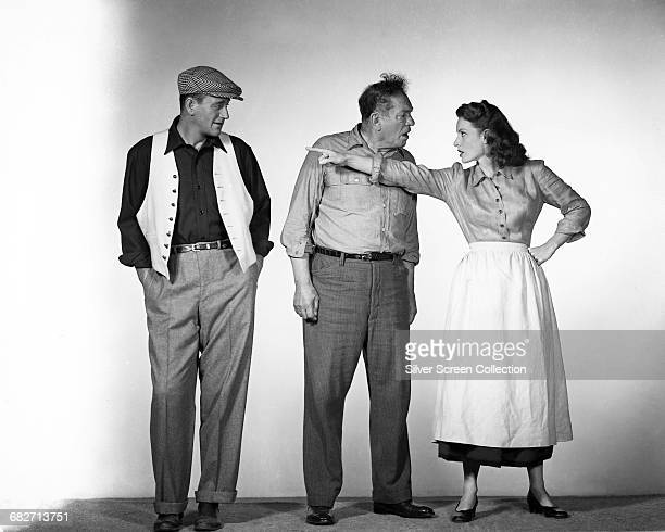 From left to right actors John Wayne as Sean Thornton Victor McLaglen as Squire 'Red' Will Danaher and Maureen O'Hara as Mary Kate Danaher in a...