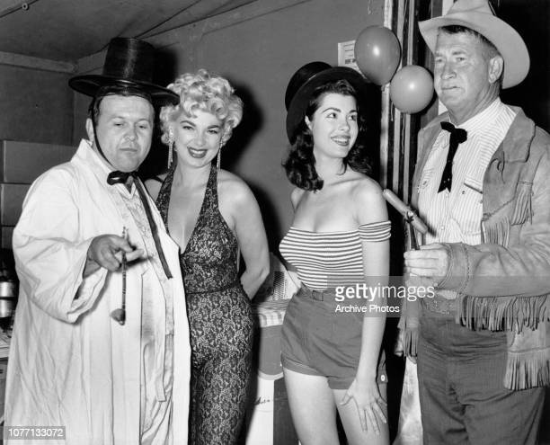 From left to right actors Johnny Grant Barbara Nichols Barbara Wilson and Chill Wills in fancy dress at the Ballyhoo Ball of the Publicists'...