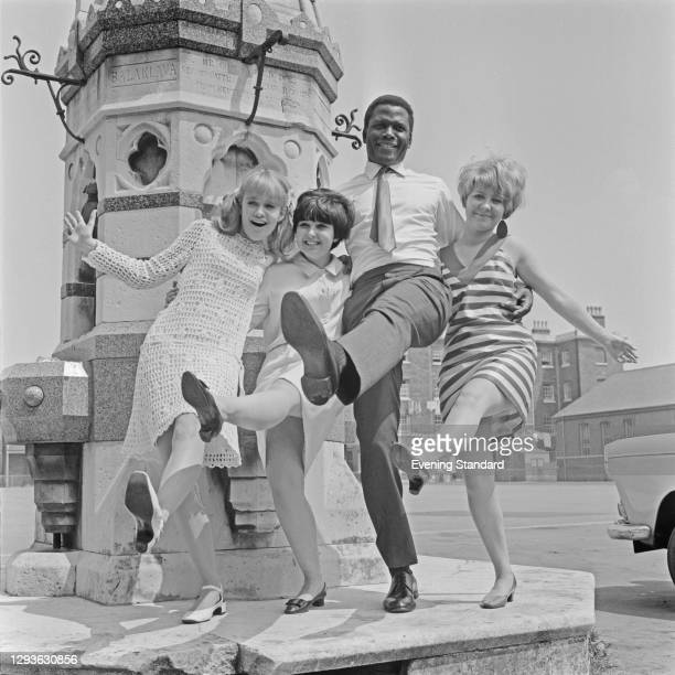 From left to right, actors Judy Geeson, Adrienne Posta, Sidney Poitier and Lulu on the set of the drama film 'To Sir, With Love', in which they all...