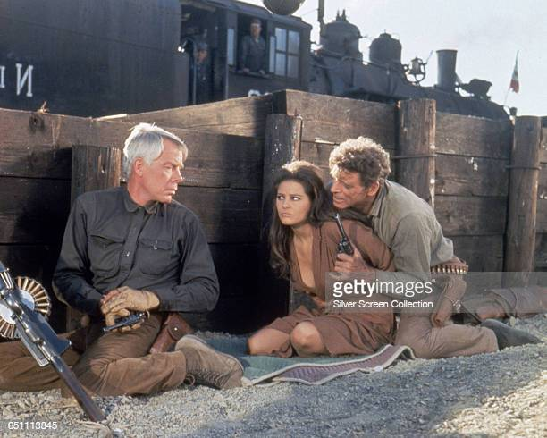 From left to right actors Lee Marvin as Fardan Claudia Cardinale as Mrs Maria Grant and Burt Lancaster as Bill Dolworth in the western 'The...