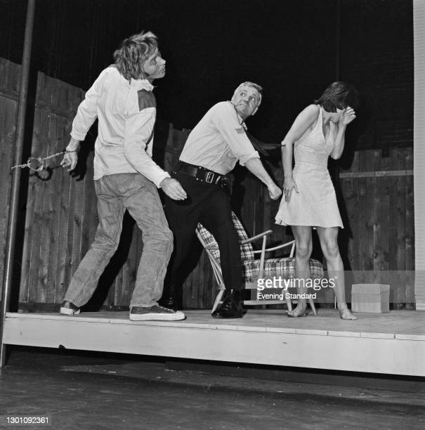 From left to right, actors Mark McManus , Ed Devereaux and Carole Mowlam appear in the stage play 'The Removalists' by David Williamson at the Royal...