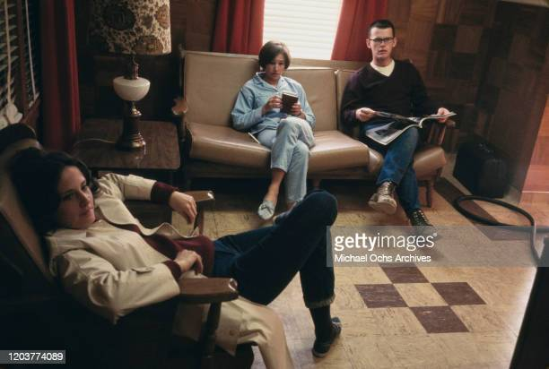 From left to right actors Mary Linda Rapelye Brenda Currin and Paul Hough in the small farming community of Holcomb Kansas during the filming of...