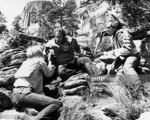 From left to right actors Melinda Dillon as Jillian Guiler Richard Dreyfuss as Roy Neary and Josef Sommer as Larry Butler near Devil's Tower Wyoming...