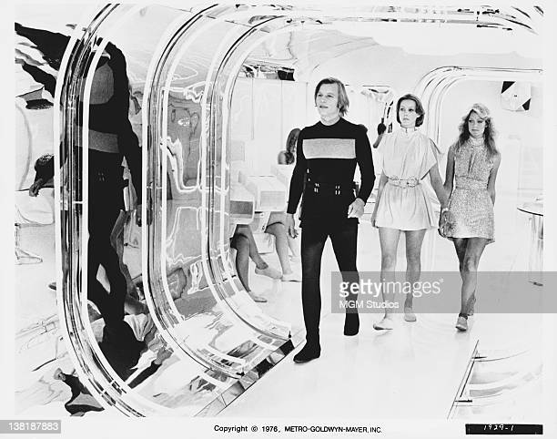 From left to right, actors Michael York, Jenny Agutter and Farrah Fawcett in a scene from the dystopian science fiction film 'Logan's Run', 1976.