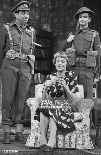 From left to right, actors Nicholas Courtney as Colonel Graham, Celia Johnson as Sybil Hathaway and Hugh Wooldridge as Robinson in the play 'The Dame...