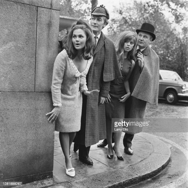 From left to right, actors Norma Foster, John Neville, Edina Ronay and Donald Houston in a variety of costumes during the filming of the Sherlock...