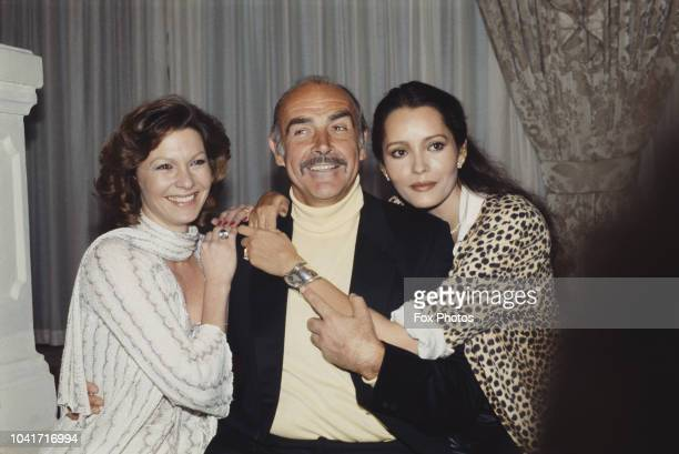 From left to right actors Pamela Salem Sean Connery and Barbara Carrera during a press launch for the James Bond film 'Never Say Never Again' at the...