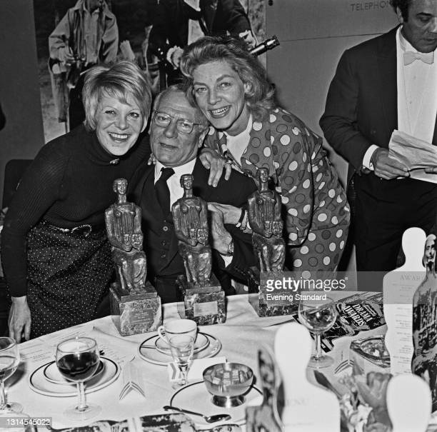 From left to right, actors Rachel Roberts , Sir Laurence Olivier and Lauren Bacall with their statuettes at the Evening Standard Drama Awards for...