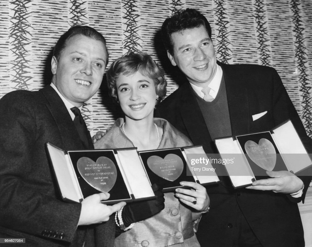 From left to right, actors Richard Attenborough (1923 - 2014), Sylvia Syms and Max Bygraves (1922 - 2012) with their awards at the Variety Club Annual Show Business Awards Luncheon at the Savoy Hotel in London, 10th March 1959. They won for 'Film Actor of 1958', 'Film Actress of 1958' and 'Show Business Personality of 1958' respectively.