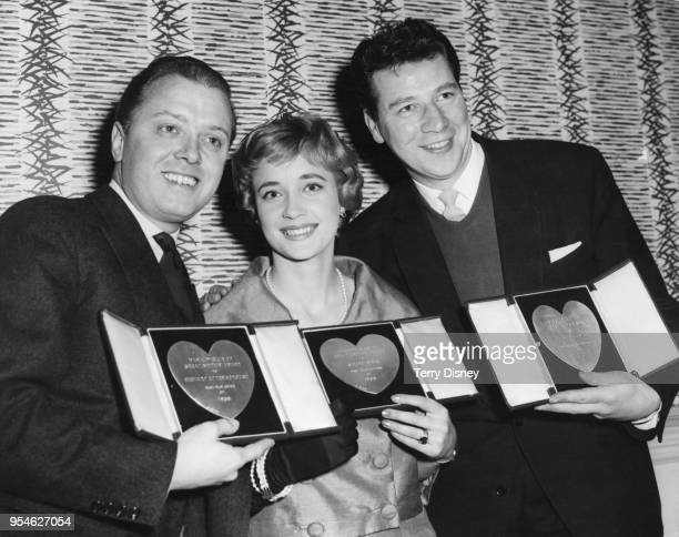 From left to right, actors Richard Attenborough , Sylvia Syms and Max Bygraves with their awards at the Variety Club Annual Show Business Awards...