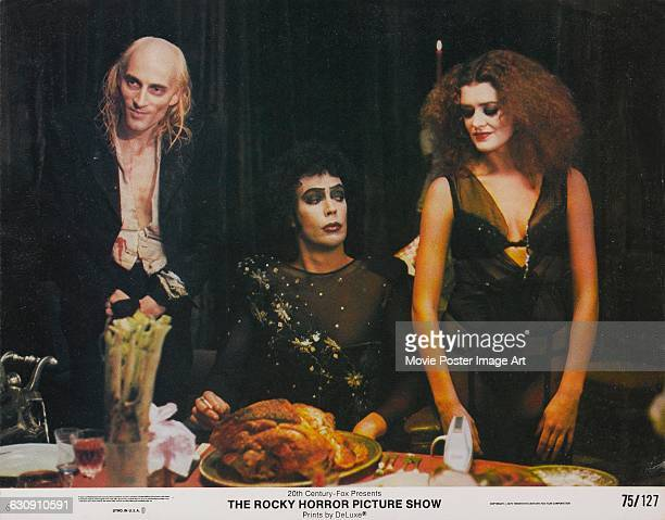 From left to right actors Richard O'Brien Tim Curry and Patricia Quinn as Riff Raff Dr FrankNFurter and Magenta respectively on a lobby card from the...