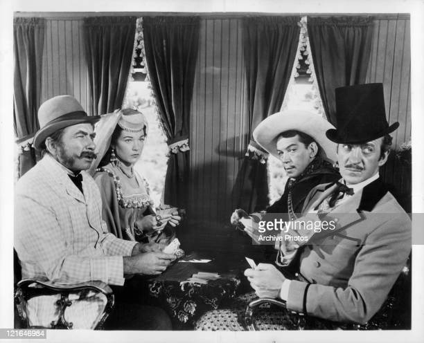 From left to right actors Robert Newton and Shirley MacLaine Cantinflas and David Niven in a scene from the film 'Around The World In Eighty Days'...