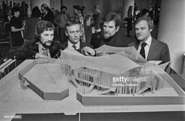 From left to right, actors Roy Dotrice , Edward Woodward , theatre director Peter Coe and Australian actor Keith Michell examine a model of the...