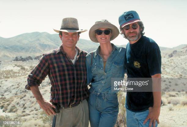 From left to right, actors Sam Neill and Laura Dern pose with American director Steven Spielberg in a publicity still for the film 'Jurassic Park',...