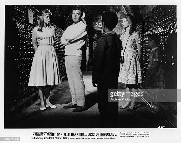 From left to right actors Susannah York Kenneth More Richard Williams Jane Asher and Elizabeth Dear in a scene from the film 'Loss Of Innocence'...