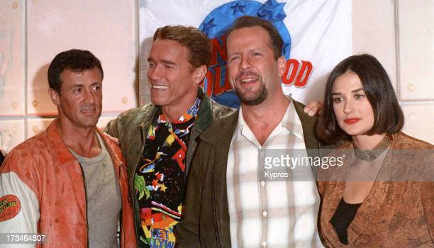From left to right actors Sylvester Stallone Arnold Schwarzenegger Bruce Willis and Demi Moore at Planet Hollywood circa 1992