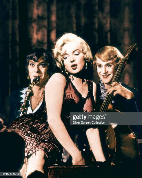 From left to right, actors Tony Curtis as saxophone player Joe/Josephine, Marilyn Monroe as singer Sugar Kane Kowalczyk and Jack Lemmon as double...