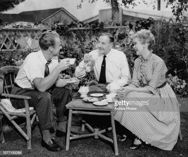 From left to right actors Van Johnson Louis Calhern and Janet Leigh take a break on the set of the MGM film 'A Steak For Connie' aka 'Confidentially...