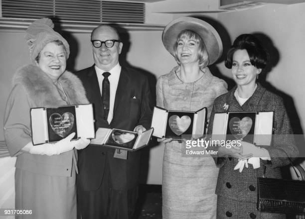 From left to right actors Violet Carson Billy Cotton Sheila Hancock and Leslie Caron with their awards at the Variety Club luncheon and 1962 awards...