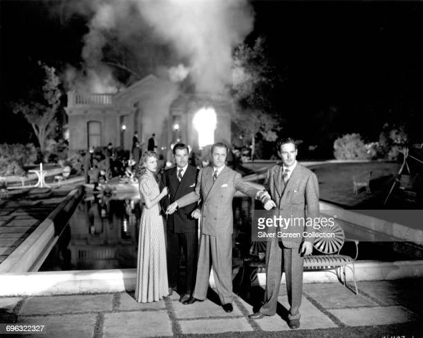 From left to right actors Virginia Grey Tom Neal William Powell and Patric Knowles in the swimming pool fire scene from the sequel 'Another Thin Man'...