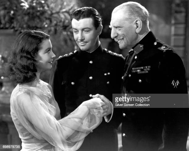 from left to right actors Vivien Leigh as Myra Robert Taylor as Roy Cronin and C Aubrey Smith as The Duke in a scene from the film 'Waterloo Bridge'...