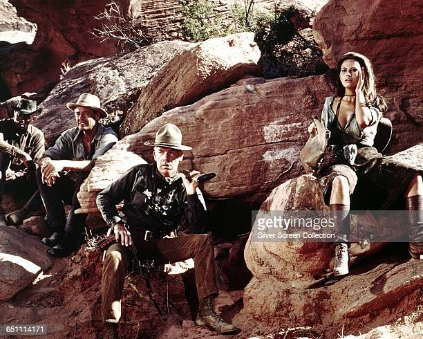 From left to right actors Woody Strode Robert Ryan Lee Marvin and Claudia Cardinale in the western 'The Professionals 1966