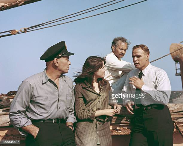 From left to right actors Yul Brynner Janet Margolin Wally Cox and Marlon Brando during the filming of 'Morituri' 1965